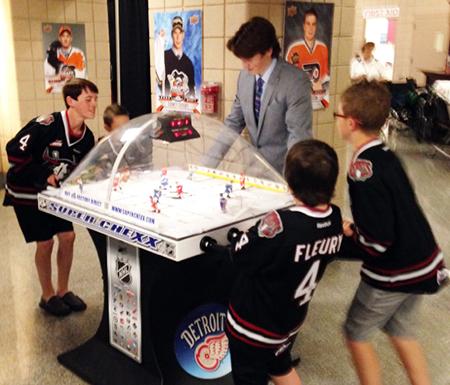 2014-NHL-Draft-Upper-Deck-Booth-Busy-Bubble-Hockey-Haydn-Fleury-2