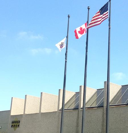 Happy-Canada-Day-Raising-Canadian-Flag-Upper-Deck-Headquarters-Three-Flying