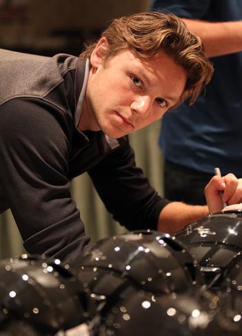 2014-NHLPA-Rookie-Showcase-Sam-Reinhart-Signing-Helmets