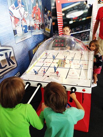 2016-upper-deck-tim-hortons-world-cup-hockey-nhl-fan-village-kids-playing-bubble-hockey