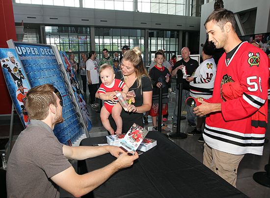 2017-nhl-draft-upper-deck-booth-autograph-session-tyler-motte-chicago-blackhawks-trade-panarin-columbus-cute-baby-signing